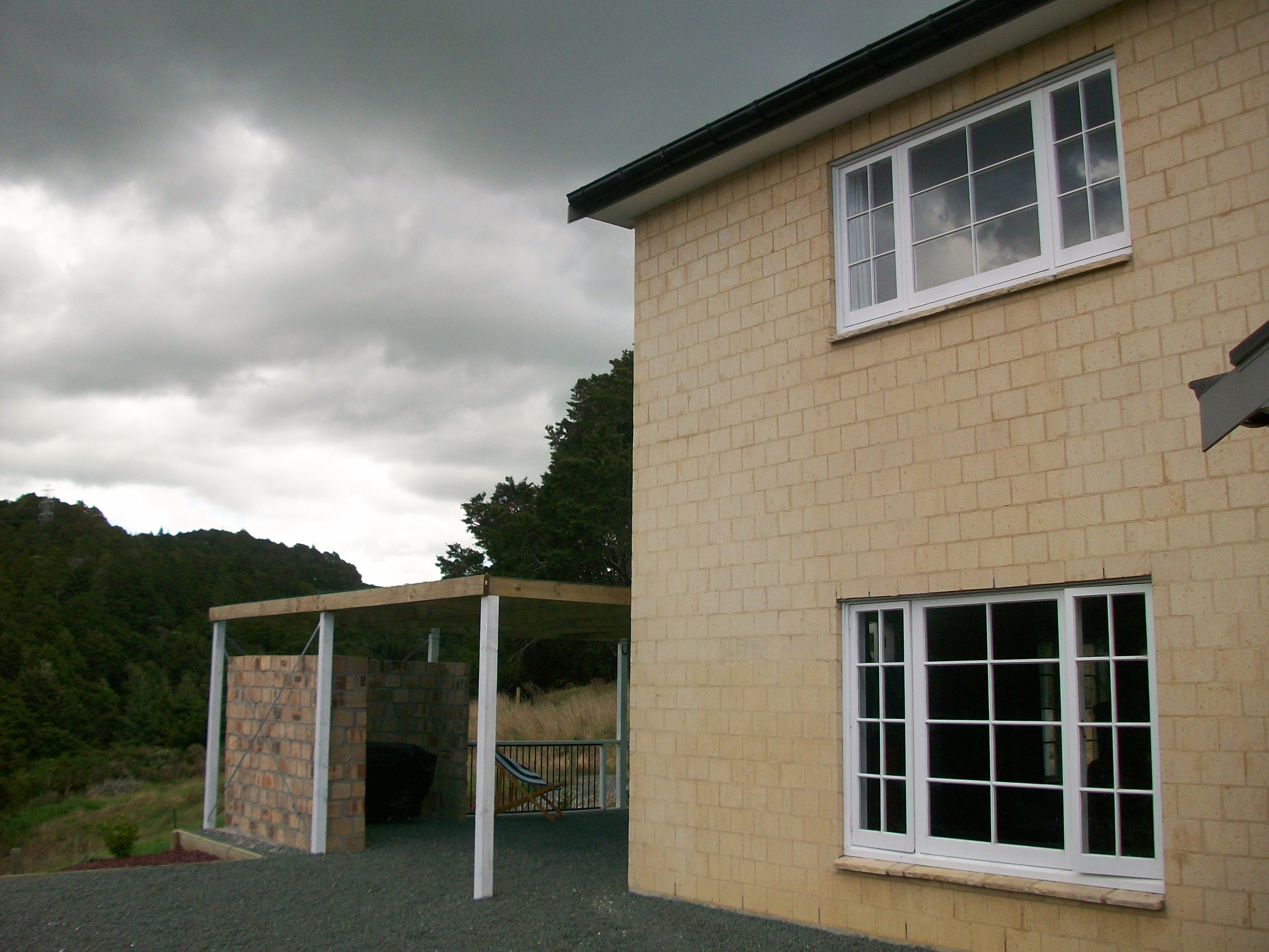 Corner of House with BBQ area showing