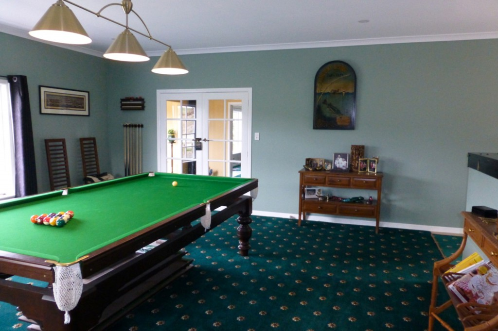 Pool Room with door through to stairwell